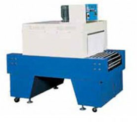 Shrink Packing Machine equipped with an adjustable speed conveyor and 2 temperature controllers for upper and lower heaters.